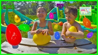 Huge Eggs Surprise Toys Challenge on Inflatable Water Slide with Hailey and Her Cousin