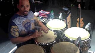 Paoli Mejias tuning congas in Santana band with Chad Tasky