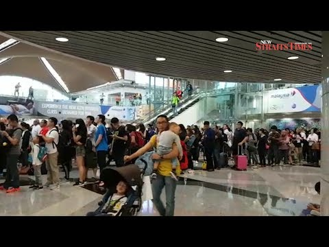 Holiday travelling passengers swamp KLIA immigration counters