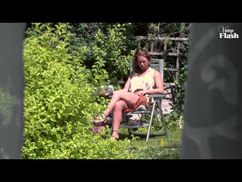 Ashleigh Embers nylon stocking tease in an English country garden