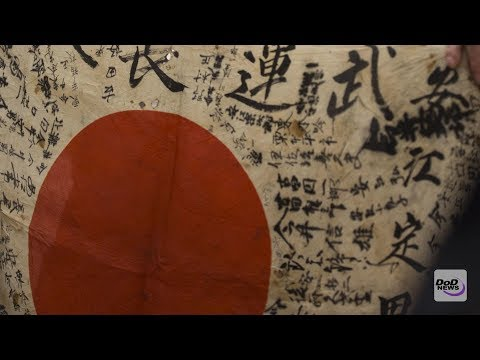 Marine Returns Flag to Family of Fallen Japanese WW II Soldier