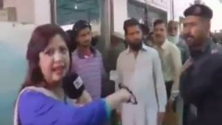 Pakistani Female journalist slapped by police man!