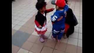 Indian Baby Girl hugging China baby boy at Beijing