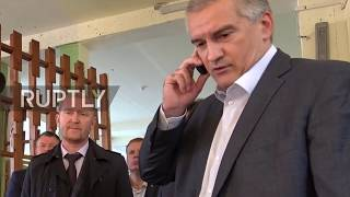 Russia: Crimean PM Aksenov visits site of Kerch college shooting