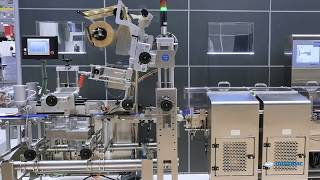 Automated traysealer line for portioning and  packaging of fresh meat with full wrap labelling
