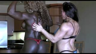 Massive black muscular Goddess and her girlfriend teasing each other