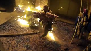Helmet camera shows firefighter catching child thrown from burning apartment