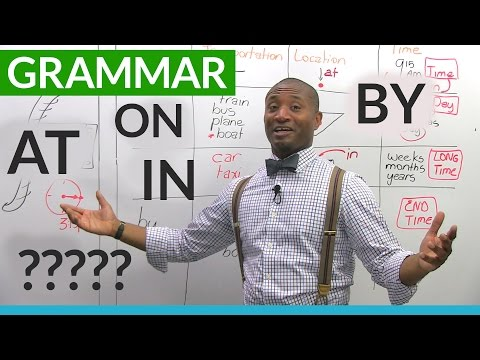 watch English Grammar: The Prepositions ON, AT, IN, BY