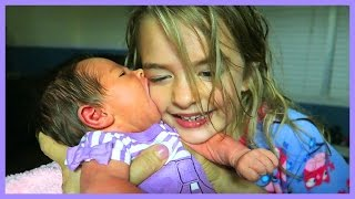 BABY TRIES TO SUCK SISTER'S FACE OFF!