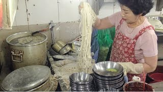 Great Skills. Fast Knife-Cut Noodles. Korea Street Food in Namdaemun Noodle Soup Alley, Seoul