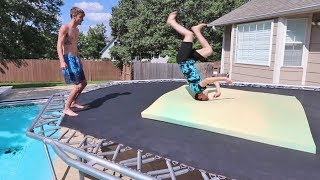 TEACHING MY UNATHLETIC BROTHER A BACKFLIP!