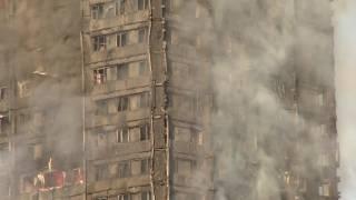 """شاهدة عيان: """"كثير سكان المبنى المحترق من العرب"""""""