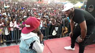 Slapdee meets young rapper Fly J on stage.