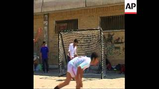 Young men practise 'street style' soccer tricks