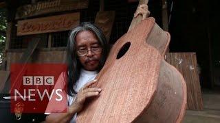 Myanmar man makes guitars from Cyclone Nargis wood - BBC News
