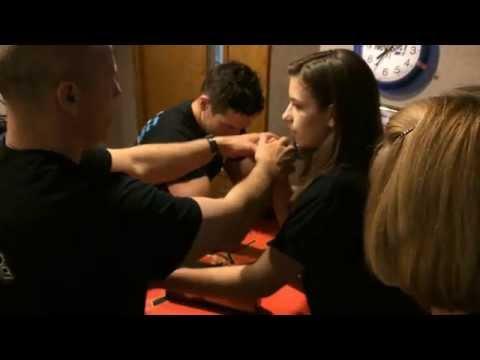 Teen Girl Arm wrestles Grown Man