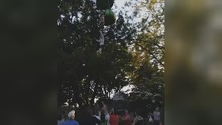 'It's OK to let go': Girl, 14, caught after falling off ride