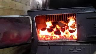 Randy stoking fire
