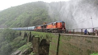 Indian Railways : Amaravati Express passing Dudhsagar waterfalls under drizzle