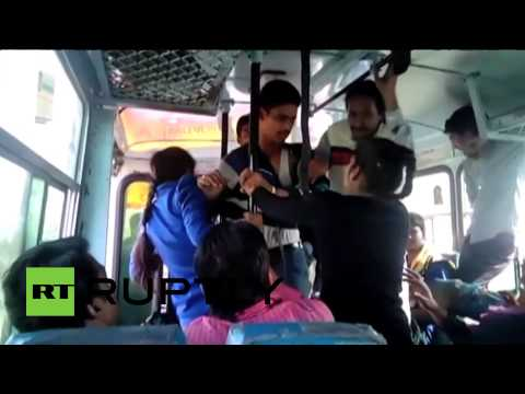 Two college girls beat molesters with belts on Indian bus