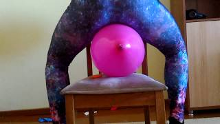 Bursting balloons with heels and leggings