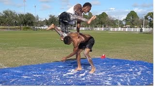 PLAYING TACKLE FOOTBALL ON A SLIP AND SLIDE