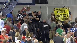 Protester choked at Trump rally as W. Virginia gov. defects to GOP