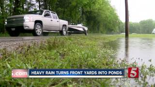 Heavy Rain Turns Front Yards Into Ponds