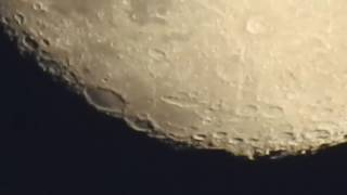 Guy Uses Camera to Zoom in on Moon