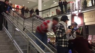 Anti-Trump protester tackled off stairs