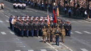 Trump salutes US troops at Bastille Day parade