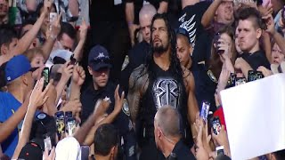 Angry Roman Reigns Pushes Brock Lesnar Fan (WWE)