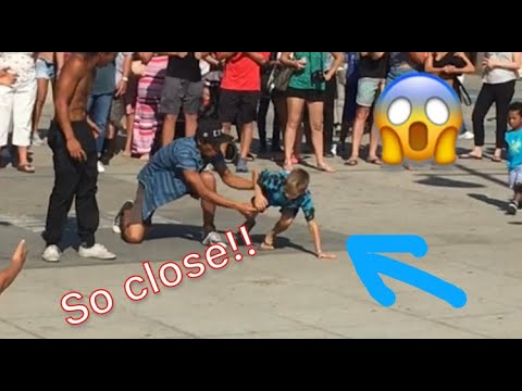 7 year old surprises street performers with a backflip