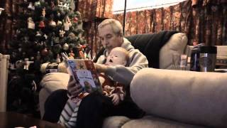Elly reads with her grandfather