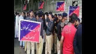 Pakistan News - Protesting cops beaten up by armed police in Pakistan administered Kashmir