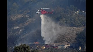Firefighters battle southern California wildfires