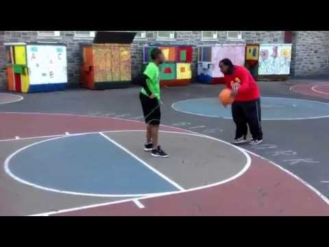 Father teaches son a lesson on the basketball court