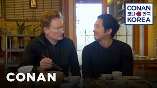 Conan & Steven Yeun Enjoy A Traditional Korean Meal
