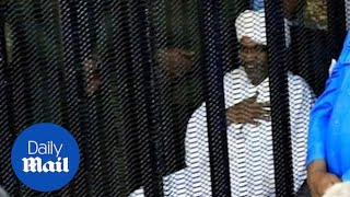 Former president of Sudan arrives for corruption trial