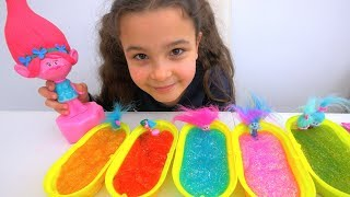 Trolls Slime Bath Surprise: Learn Colors with Trolls Poppy Toy and Glitter Slime