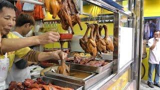 Hong Kong Street Food. The Roasted Bird Dipped in Sauce