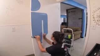 Timelapse of The Helvetica Man being painted on bathroom door