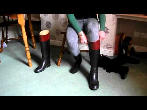 putting on aigle riding boots.mp4
