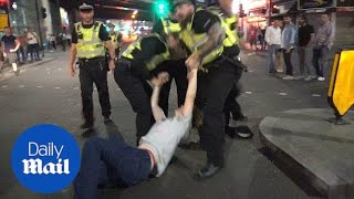 Fans and police clash in in London after England defeat