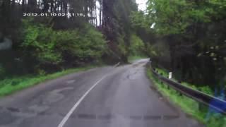 Fallen Trees Trap Car on Road
