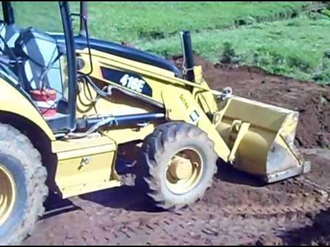 Retroescavadeira Caterpillar 416E Q.M. Filhos