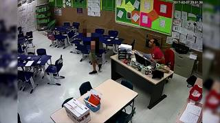 Teacher arrested, caught on camera kissing student
