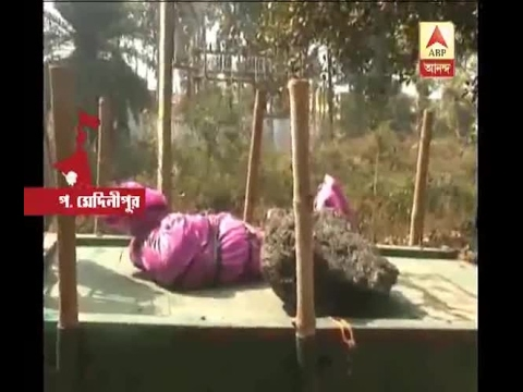 Rotten body of a woman recovered from a pond at Jhargram police station area