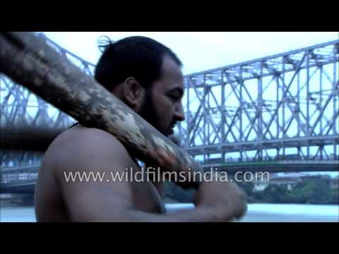 Desi pehelwan exercises next to Howrah bridge in Kolkata