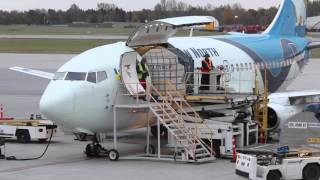 Classic Boeing 737-200 Combi Unloading - Passengers & Cargo - Canadian North Airlines